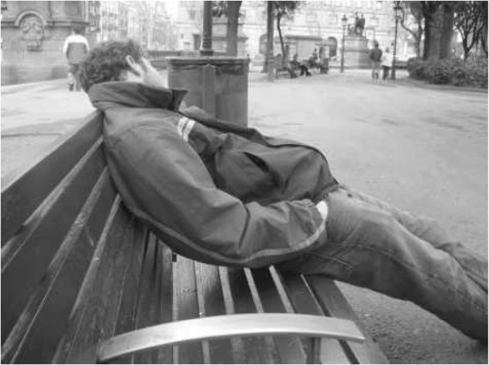 Man sleeping on a park bench